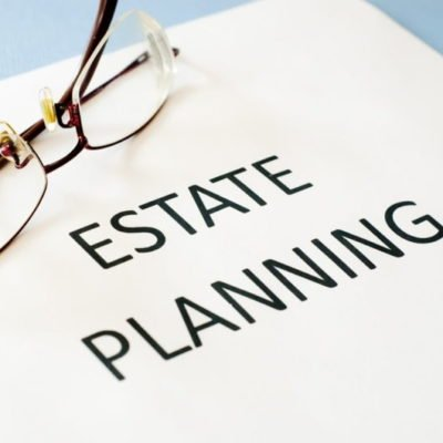Photo Of Estate Planning Written On Paper